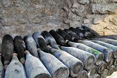 Постер, плакат: The ancient bottles of wine in the ancient cellar