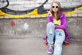 picture of snickers  - Blond teenage girl with lollipop urban outdoor portrait - JPG