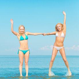 stock photo of denude  - On a Beach Pleasure Models  - JPG