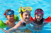 pic of swimming pool family  - Happy kids playing and having fun together in the pool - JPG