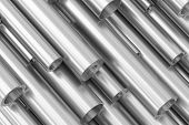 Many Different Various Sized Steel Pipes. poster