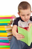 Preschooler Leaning Against Pile Of Books