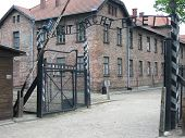 stock photo of auschwitz  - The photo shows the entrance to the Auschwitz concentration camps situated in Oswiecim Poland - JPG
