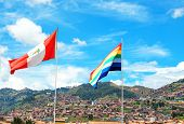 Peru Flag And Cusco Flag On The City Roofs And Blue Sky Background. Peru, Latin America. Horizontal poster