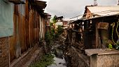 Poor Area With Slums And Sewers In Indonesia. Poor Asian City Block poster