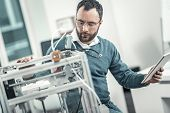 Serious Professional Adult Engineer Testing 3d Printer poster