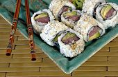 Sushi Rolls With Chop Sticks poster