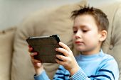 Leisure, Children, Technology And People Concept. Boy With Tablet Pc Computer On A Soft Couch At Hom poster
