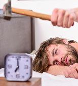 Guy Knocking With Hammer Alarm Clock Ringing. Break Discipline Regime. Annoying Sound. Man Bearded A poster