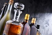 Carafe And Bottles Of Assorted Alcoholic Beverages. poster