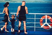 Family Travel With Kid On Mothers Or Fathers Day. Mother And Father With Son Look At Sea On Beach. S poster