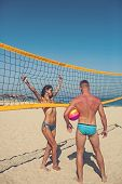 Woman And Man Doing Sport On Beach. Victory And Reward Concept. Young Sporty Active Couple Stand Nea poster