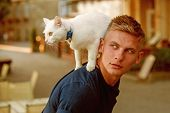 Wanting To Know About Everything. Cat Stands On Back Of His Owner. Happy Man On Walk With Cat Pet. M poster