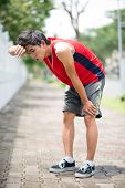 stock photo of breath taking  - Young young sportsman taking breath outdoors alone - JPG