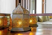 stock photo of lamp shade  - Interesting table lamp on a corner unit shaped like an oriental lantern with electric tungsten bulb - JPG