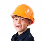 stock photo of edentate  - Cheerful little girl in a protective helmet - JPG