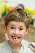 stock photo of tooth gap  - Cute Boy smiling without one teeth  - JPG