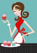 foto of apron  - Pretty smiling woman with apron holding cupcake - JPG