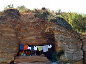 image of wet pants  - Cave of the shell clothes drying on a rope - JPG