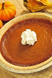 foto of pumpkin pie  - Whole pumpkin pie with fresh whipped cream - JPG