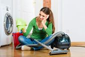 pic of spring-cleaning  - Young woman cleaning at home - JPG