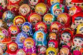 stock photo of doll  - Colorful russian wooden dolls at a market in Trakai Lithuania - JPG