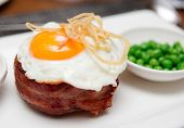 Tenderloin steak with fried egg and green pies, british cuisine dish