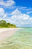 Virgin tropical beach with turquoise water at Cayo Coco (Coco key) in Cuba (on a summer day with puf
