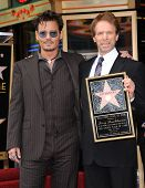 LOS ANGELES - JUN 23:  Johnny Depp & Jerry Bruckheimer arrives to the Walk of Fame Honors Jerry Bruc