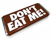 The words Don't Eat Me on a chocolate candy bar wrapper telling you this is unhealthy junk food that