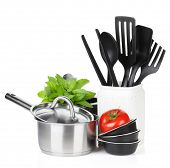 Kitchen utensils, tomato and mint leaves. Isolated on white background