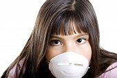 stock photo of the mexican swine flu  - Studio shot of girl wearing a particle mask  - JPG