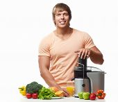 image of juicer  - Athletic man with a juicer on a white background - JPG