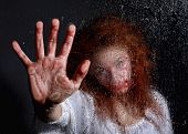 stock photo of terrorism  - Woman in Horror Situation With Bloody Face - JPG