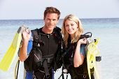 foto of flipper  - Couple With Scuba Diving Equipment Enjoying Beach Holiday - JPG