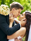 picture of hand kiss  - Bride and groom  kissing  outdoor - JPG