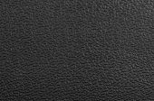 image of sandblasting  - Closeup detail of black plastic surface texture - JPG