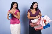 stock photo of envy  - The woman in pink with little bag envy her friend wealth and success - JPG
