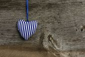 Blue Striped Love Valentine's Heart Hanging On Wooden Texture Background