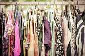 image of down jacket  - clothes on a rack on a flea market - JPG
