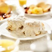 stock photo of biscuits gravy  - biscuits with sausage gravy - JPG