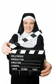 stock photo of nun  - Nun with movie board isolated on white - JPG