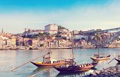 stock photo of old boat  - traditional boats with wine barrels old Porto Portugal warm toned - JPG