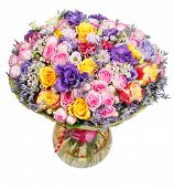 stock photo of chrysanthemum  - bouquet of flowers from roses and chrysanthemums in glass vase isolated on white background - JPG