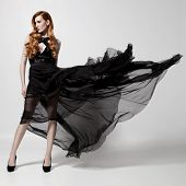 foto of flutter  - Fashion woman in fluttering black dress - JPG