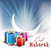stock photo of eid card  - Beautiful greeting card design with crescent white moon and gift boxes on shiny blue background for the celebration of Muslim community festival Eid Mubarak - JPG
