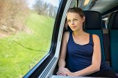 picture of passenger train  - Young woman traveling by train - JPG