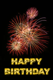 stock photo of happy birthday  - picture of fireworks with text happy birthday in gold - JPG