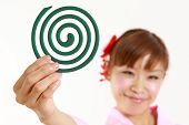 stock photo of mosquito repellent  - Young woman wearing Japanese kimono with mosquito coil - JPG