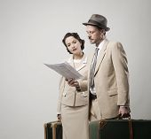 picture of leaving  - Elegant couple leaving for vacations with luggage 1950s style - JPG